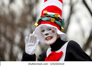 Prescott, Arizona, USA - December 1, 2018: Woman wearing a Cat in the Hat costume and waving while participating in the Christmas parade in downtown Prescott