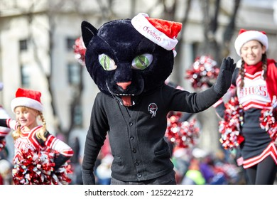 Prescott, Arizona, USA - December 1, 2018: Sacred Hearts Catholic School student in black cat costume participating in the Christmas parade in downtown Prescott
