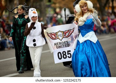 Prescott, Arizona, USA - December 1, 2018:  Female Super Heroes with Heroes United in Christmas Parade