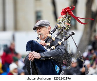 Prescott, Arizona, USA - December 1, 2018: Man playing the bagpipes participating in the Christmas parade in downtown Prescott