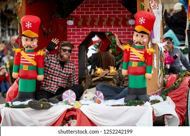 Prescott, Arizona, USA - December 1, 2018: Man waving on a decorated float in the Christmas parade in downtown Prescott