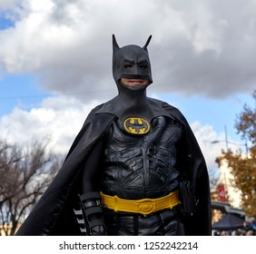 Prescott, Arizona, USA - December 1, 2018: Man wearing a batman costume  while marching in the Christmas parade in downtown Prescott