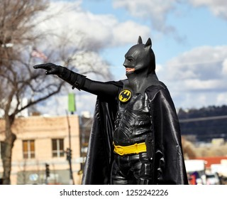 Prescott, Arizona, USA - December 1, 2018: Man wearing a batman costume waving while marching in the Christmas parade in downtown Prescott
