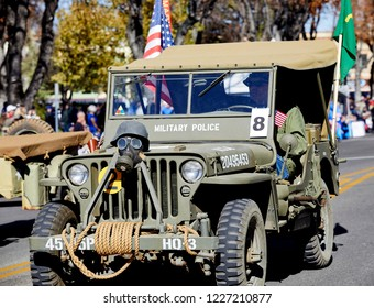 Prescott, Arizona, USA - November 10, 2018: Korean War Veterans driving a military vehicle in the Veteran's Day Parade on Cortez St.