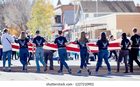 Prescott, Arizona, USA - November 10, 2018: Prescott High School Air Force JR ROTC carrying a large US flag while marching  in the Veteran's Day Parade on Cortez St.