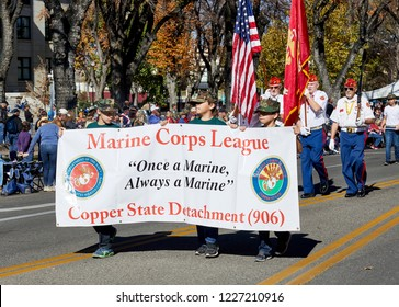 Prescott, Arizona, USA - November 10, 2018: Marine Corps Banner in the Veteran's Day Parade on Cortez St.