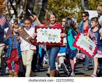 Prescott, Arizona, USA - November 10, 2018: Girl Scouts marching  in the Veteran's Day Parade on Cortez St.