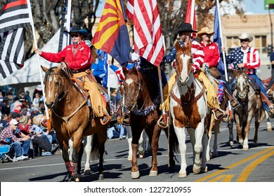 Prescott, Arizona, USA - November 10, 2018: Horses with Riders marching  in the Veteran's Day Parade on Cortez St.