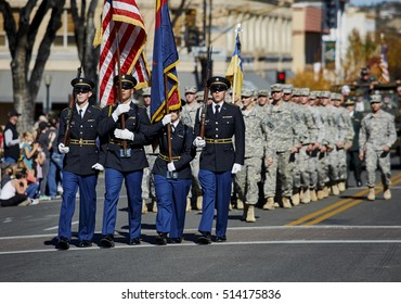 Prescott, Arizona, USA - November 11, 2016: ROTC members marching together holding flags in Veterans day Parade