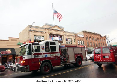 Prescott, Arizona/USA- July 03, 2013: An American flag flies at half staff in downtown Prescott, Arizona. The Yarnell Hill fire killed all but one member of a 20-strong 'hotshot' firefighting team.