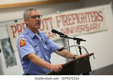 Prescott, Arizona/USA-July 03, 2013: Prescott Fire Department spokesman Wade Ward speaks at a press conference at Prescott High School. The Yarnell Hill fire killed 19 firefighting hotshots.