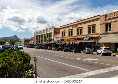 Prescott, AZ / USA - Circa August 2019: Gurley street facing the Lone Spur Cafe on a beautiful summer day with blue skies and large fluffy white clouds, row of parked cars.