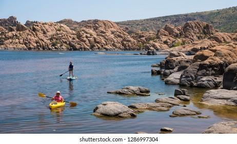 Prescott, AZ / USA - July 27, 2018: Two women enjoying water activities at Watson Lake nearby Prescott