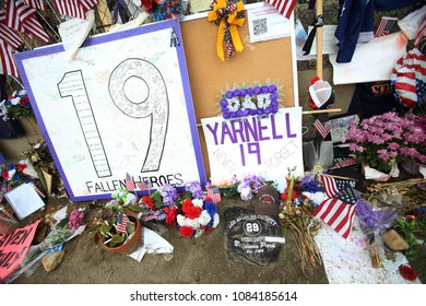 Prescott, AZ/USA- July 12, 2013: A memorial for of the 19 fallen hotshot firefighters formed on a fence outside of Granite Mountain Hotshots Fire Station 7 in Prescott, Arizona.