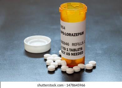 Prescription bottle with backlit Lorezapam tablets. Lorezapam is a generic prescription anti-anxiety medication. A concept for mental health.