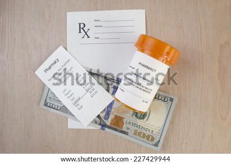 prescription bottle receipt and blank script on desktop