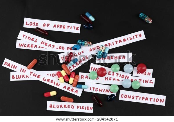 Prescription drug lottery on black background, close-up