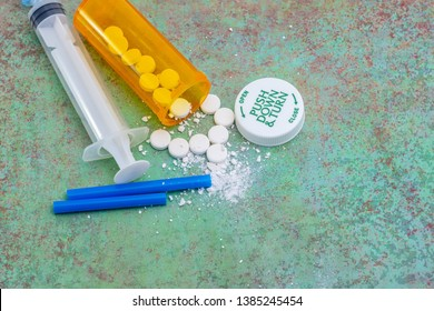 Prescription drug and opioid crisis in the United States and parts of the world. Health care concept and crushed drugs with straw.