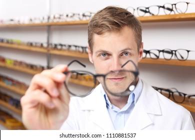 Prescription glasses.  Optometrist chooses eyeglass frames in the optical salon.
