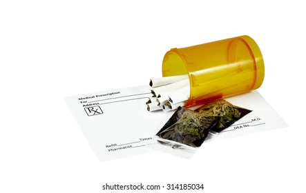 Prescription marijuana cigarettes in pill container with blank prescription form and packets of dried marijuana leaves.