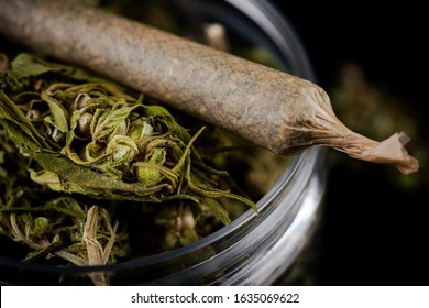 Prescription Medical Marijuana Joint and Cannabis Flower Buds in Jar. CBD and Cannabidiol Marijuana.