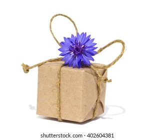 Present box with twine and cornflower isolated white background