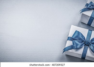 Present boxes on blue background greeting card holidays concept.