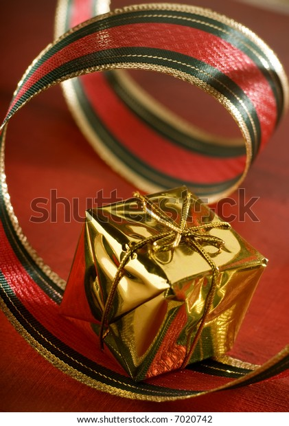 present decorated with red ribbon close up