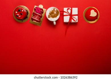 Present and deserts on a bright red background with a copy space