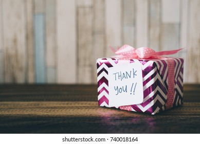 present / gift with a thank you note. handwritten thank you note on a gift / present. thank you card with copy space.