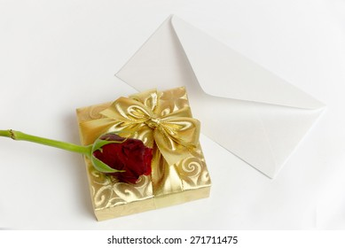 Present with letter and red rose