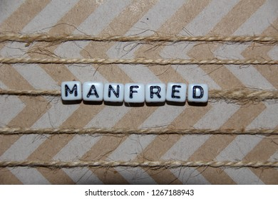 Present with letters Manfred