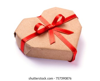A present with love. Gift box in the shape of a heart made from kraft paper with a red ribbon isolated on white background.