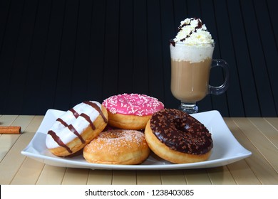 presentation of fruit and chocolate donuts
