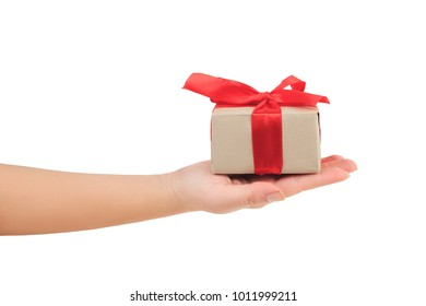stock photos images photography shutterstock presentation of gift present on the palm hand giving a gift wrapped with red negle Choice Image