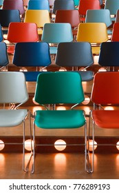 Presentation hall with rows of colored chairs