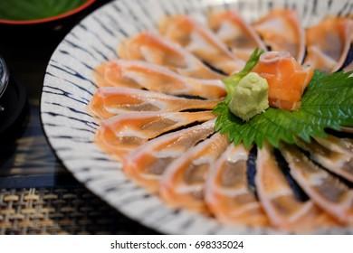 Presentation of raw fresh salmon sashimi sliced thinly