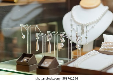 Presentation of retail showcase in jewellery store with necklaces and other jewellery