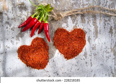 Presentation of two hearts made of chili powder