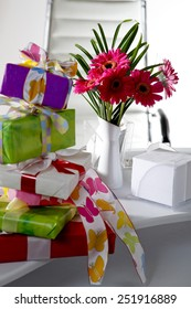 Presents and flower vase on office table