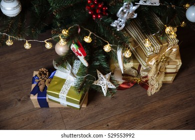 Presents, gift under the Happy New Year and Christmas tree. Concept of  family