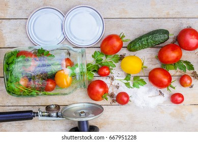 Preservation, pickling vegetables of tomatoes and cucumbers. Selective focus.