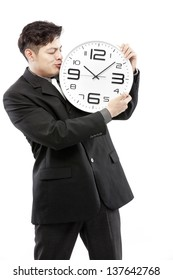 preservation of times,close up of young businessman with analog clock isolated on white background
