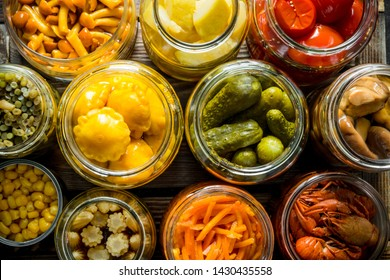 Preserved food in glass jars. Top view