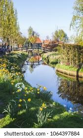 Preserved historic houses in Zaanse Schans on the banks of the river Zaan, near Amsterdam, Zaandam, North Holland, Netherlands