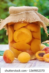 Preserved home-made apricots in jars. Selective focus. Food.