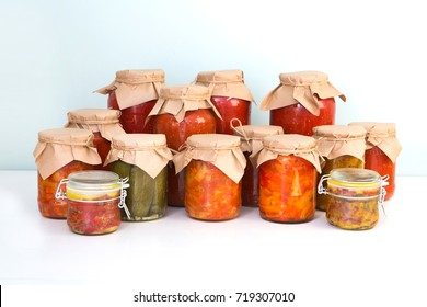 Preserved on home table. Various homemade conserves in glass jars