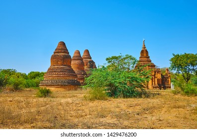 Preserved stupas and shrines of Htupalaysutan complex, located among tropical savannah forest, Bagan, Myanmar