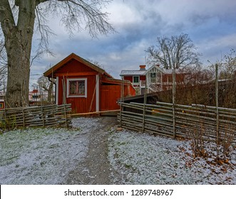 Preserved traditional swedish wooden red ochre hut at winter day in Skansen open-air museum. Stockholm, Sweden.