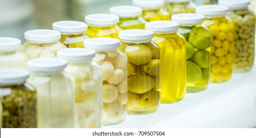 Preserved vegetables and fruits in preserve glass bottle or preserve jar on shelf in laboratory.Preserved process Must be clean and sterile